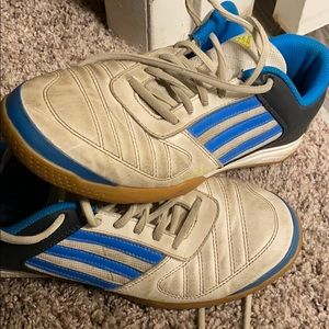 Adidas, worn with lots of wear still left.